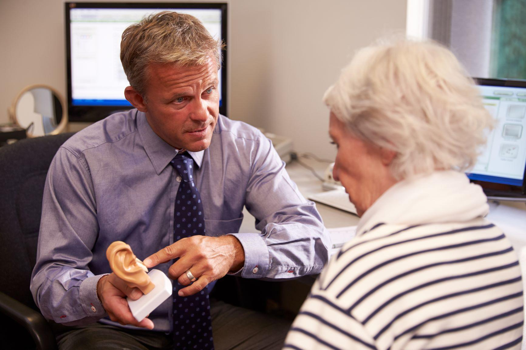 Doctor talking to patient about hearing health